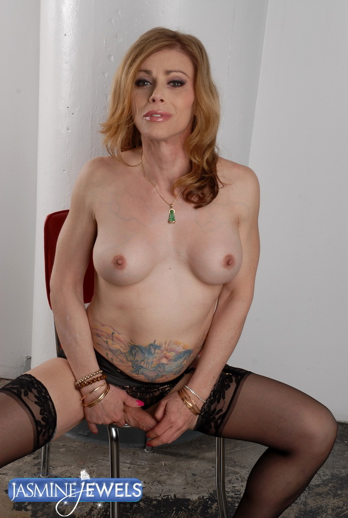 Hot Transsexual MILF Posing In Kissable Black Stockings
