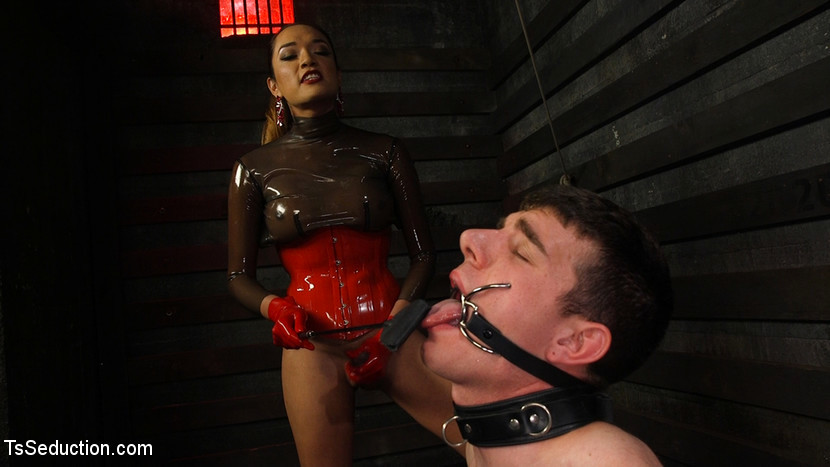 Latex Clad Domme Torments Rough Cocked Slaveboy