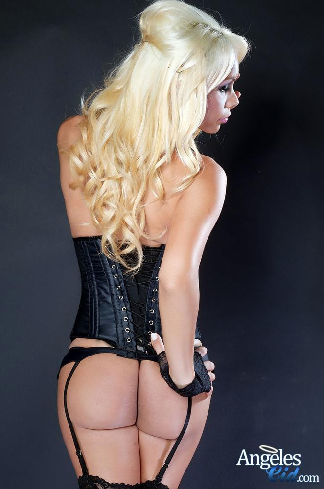 Provoking Blonde TGirl In Leather Corset