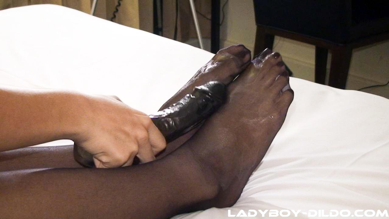 Slick And Shiny Tgirl Feet Caress A Fat Black Vibrator