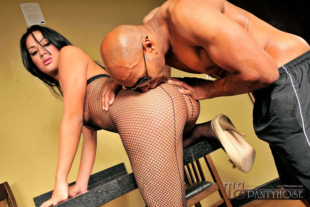 T-Girl Unleashes A Load In Fishnet Hose